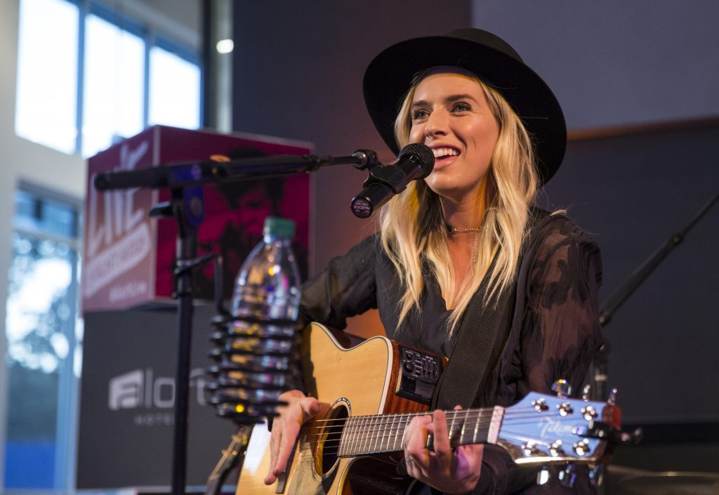 ZZ Ward playing guitar at Aloft Seattle Redmond