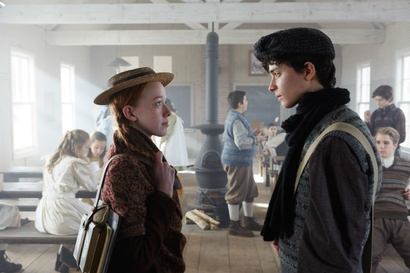 Anne Shirley (Amybeth McNulty) and Gilbert Blythe (Lucas Jade Zumann) at school.